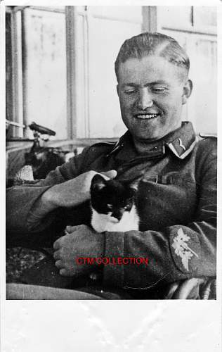 Photo of a Luftwaffe man stroking pussy