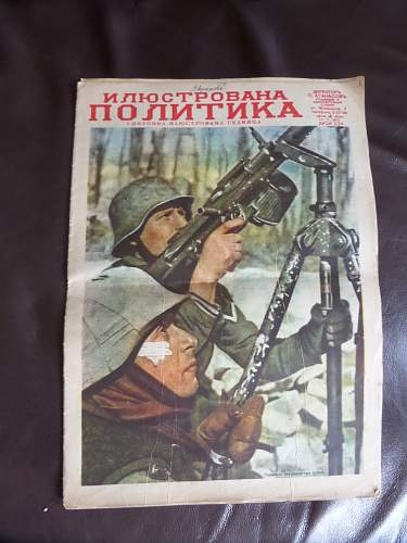 2x German magazines Russian text?