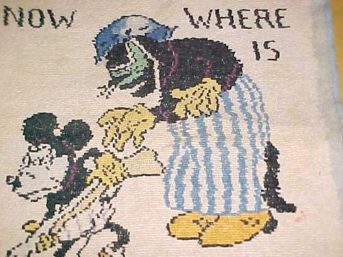 Can anyone tell me what this is?  Mickey Mouse w German Cat cloth