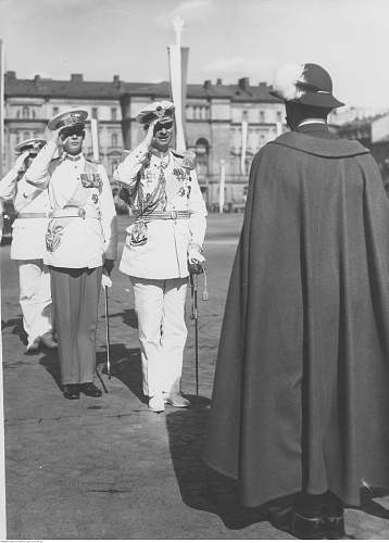Click image for larger version.  Name:27th June 1937 Warsaw King Karol II and Crown Prince Michael both wearing the sash and star of t.jpg Views:3 Size:207.3 KB ID:1138739