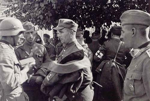 Click image for larger version.  Name:German Soldier Speaks w Polish POW.jpg Views:668 Size:68.2 KB ID:160727