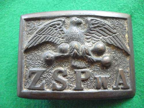 Polish and American belt buckles from the 2nd Republic era.