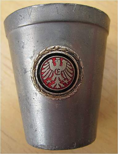 mysterious tin cup with heraldic eagle