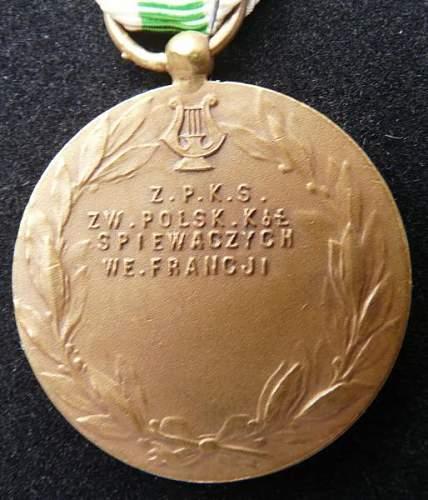 polish medal, help needed (music band ??)