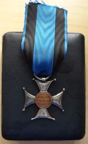 Virtuti Militari and  eagle of 1st Cavalry Regiment of Legions.