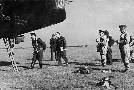 Name:  Skarzynski 3rd from right with his crew boarding their plane.jpg Views: 316 Size:  78.6 KB