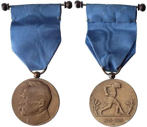 Click image for larger version.  Name:10th Anniversary of Independence Medal obv and rev.jpg Views:7 Size:140.4 KB ID:1000807