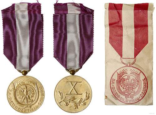 Click image for larger version.  Name:10 Year Long Service Medal obv and rev with award packet.jpg Views:41 Size:231.3 KB ID:1000809