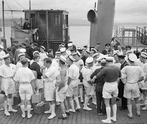 Click image for larger version.  Name:Survivors of the  ORP Kujawiak sunk by a mine in the Med come ashore at Greenock, still wearing .jpg Views:13 Size:141.6 KB ID:1007513