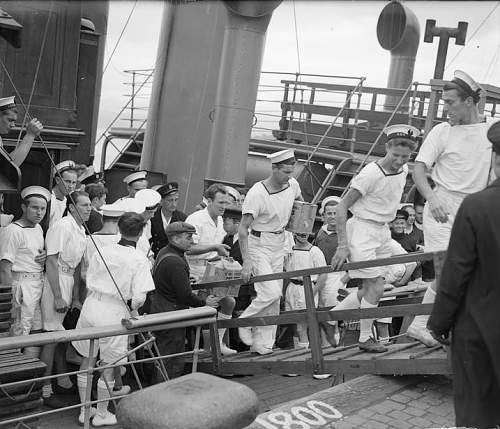 Click image for larger version.  Name:Survivors of the ORP Kujawiak, sunk by a mine  in the Med come ashore at Greenock, still wearing.jpg Views:8 Size:138.5 KB ID:1007514