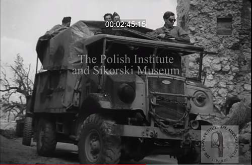 Need your help for identify soldier on photo (inside truck)