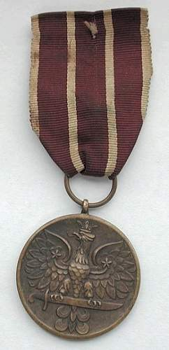 Click image for larger version.  Name:pszz war medal.jpg Views:19 Size:110.0 KB ID:205499