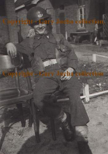 Click image for larger version.  Name:Unknown sitting on chair.JPG Views:483 Size:163.4 KB ID:59715