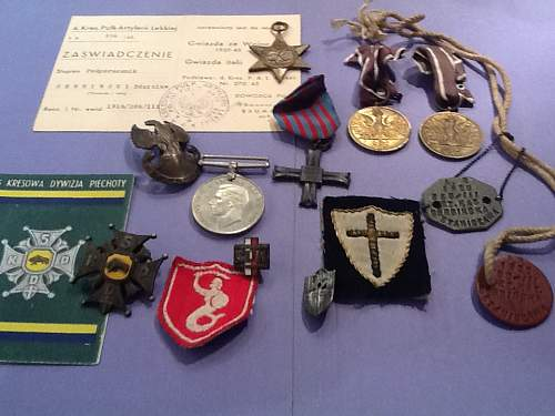 Click image for larger version.  Name:WWII medals.jpg Views:136 Size:66.6 KB ID:696563