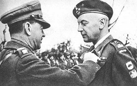 Name:  Field Marshal Alexander pinning the ribbon of the DSO onto the tunic of Plk Rudnicki.jpg Views: 1764 Size:  26.5 KB