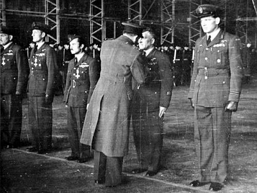 Click image for larger version.  Name:Chor pil Piotr Nowakowski receiving his DFM in 1946 from AM R Cohrane.jpg Views:104 Size:55.3 KB ID:816515