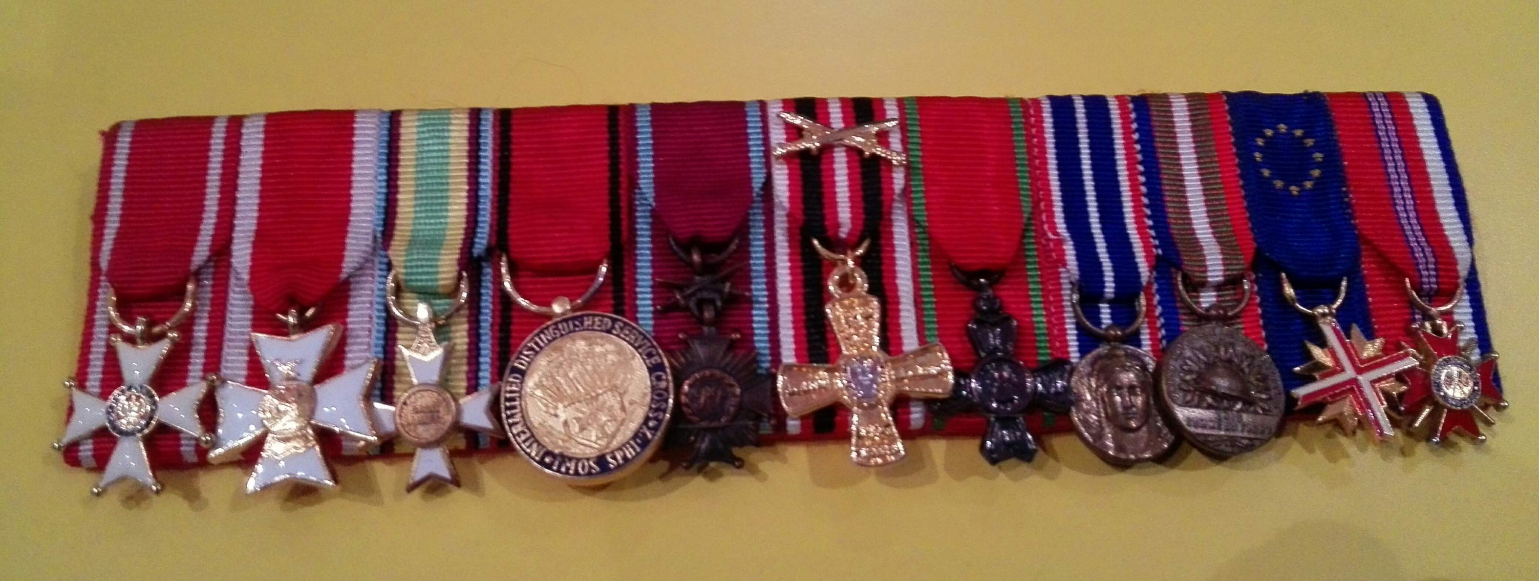 Question Mounted miniature medals group including Polonia Restituta