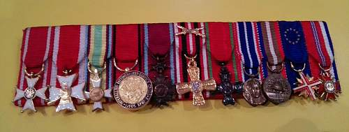 Mounted miniature medals group including Polonia Restituta.