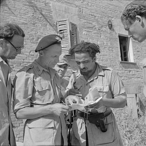 Click image for larger version.  Name:31st Aug 1944 Pesario suburbs PPlk St Zakrzewski confers with an Italian Officer who was first i.jpg Views:246 Size:109.4 KB ID:937017