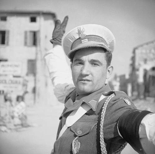 Click image for larger version.  Name:17th March 1945 Kapral Bronislaw Zagorski 5th MP Sqdn 5KDP directing traffic on the Russi Road .jpg Views:185 Size:67.2 KB ID:937026