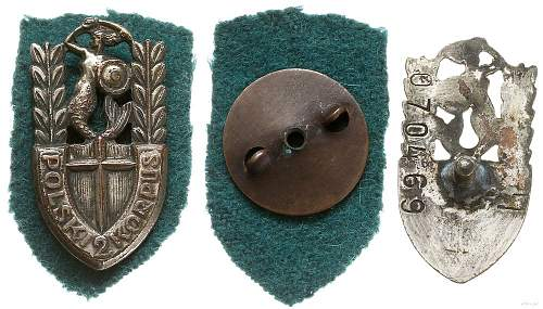 Click image for larger version.  Name:2nd Corps Badge obv and rev with retaining nut.jpg Views:37 Size:127.4 KB ID:955373