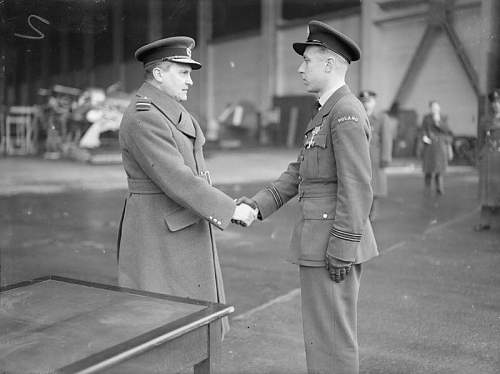 Click image for larger version.  Name:Zdzislaw Hennenberg shaking hands with AVM Sholto Douglas after receiving the DFC.jpg Views:33 Size:53.7 KB ID:995600