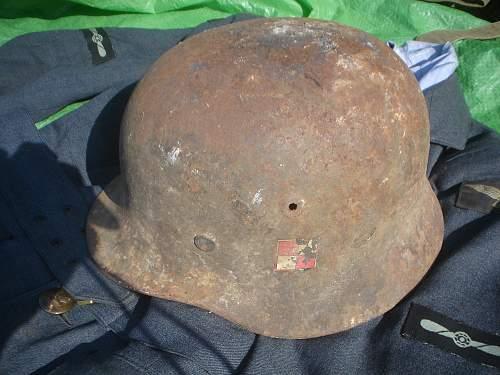 German Helmet with Polish Emblem on it ?