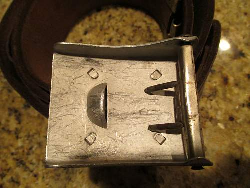 unmarked buckle with belt