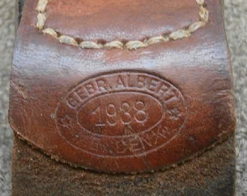 Unusual leather tab on the buckle.