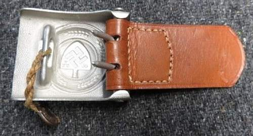 RAD buckle with the badge of the procurement service
