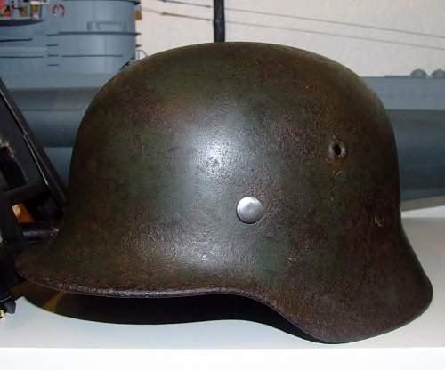 battle-damaged SD M40 helmet