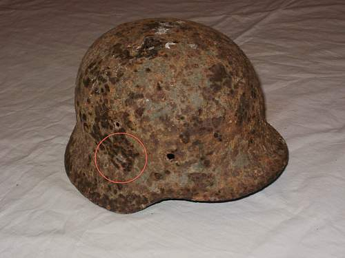 Is it a decal visible on this rusty german helmet ?