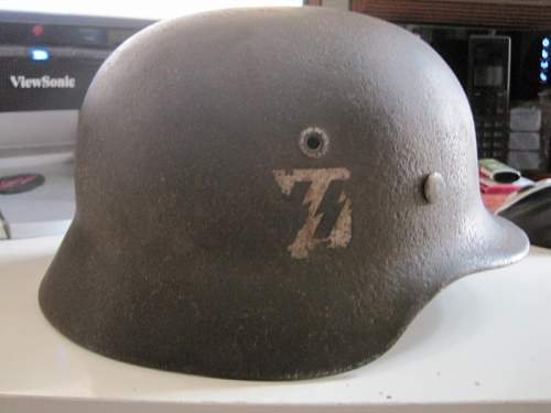 Opinion and Value on this Relic Helmet needed