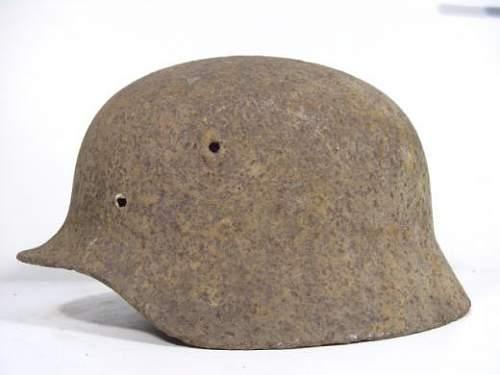 Relic M40 helmet with screw in vent hole???