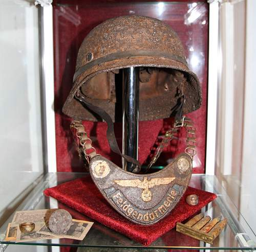 My Kurland Feldgendarmerie gorget and helmet display