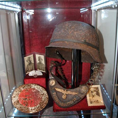 My Kurland Feldgendarmerie gorget and helmet display