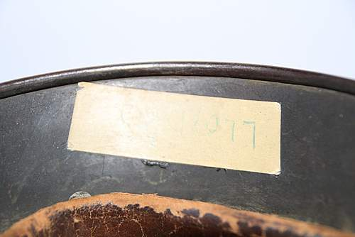 Removing post-war added piece of tape from helmet?