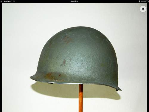 Stripping the paint off a M1 helmet