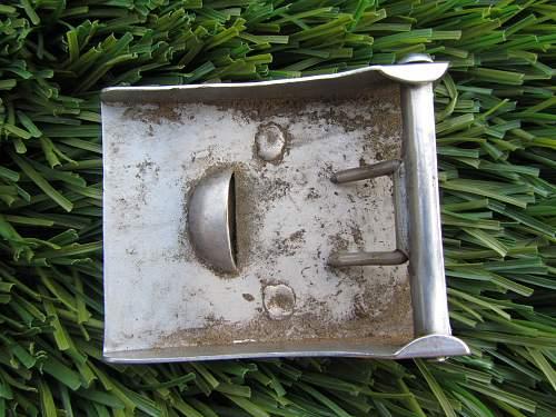 Help Identifying Belt Buckle found in Garbage!