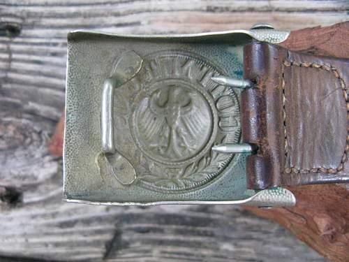SA buckle, probably a fake.