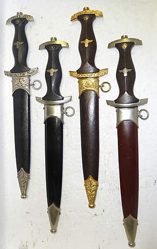 Four reproduction daggers