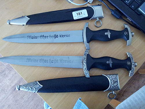 Four better grade reproduction daggers