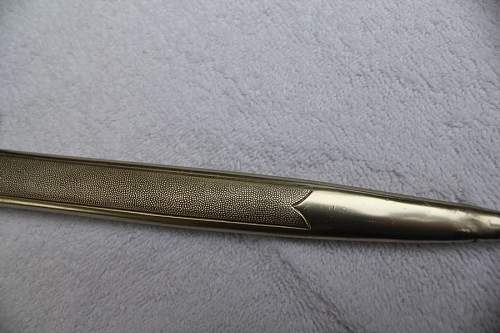 Click image for larger version.  Name:closeup of scabbard feld.jpg Views:110 Size:84.4 KB ID:596521
