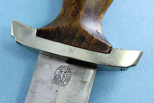 Blade / crossguard fitting