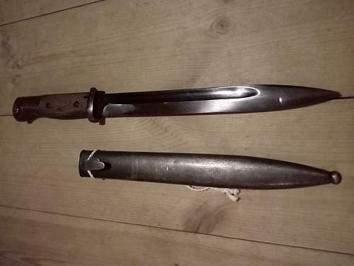 K98 bayonet with strange numbers on scabbard and handle.