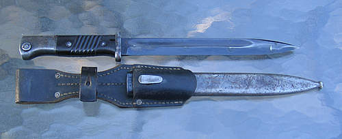 Two K98s both with matching scabbards; question on ones finish