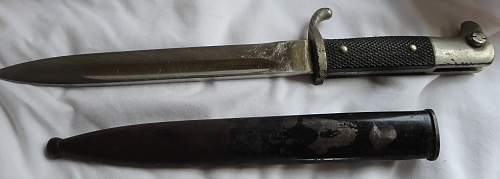 Short  Military bayonet with red insert, please help to ID