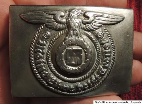 SS nickel OLC belt buckle genuine?