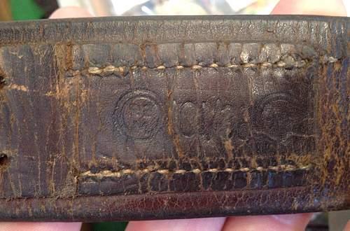 Fake SS leather markings ( belt & cross straps D rings etc)