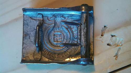 SS belt buckle is it real? got to meet someone today so need answere please!!!